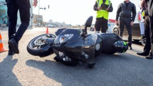 Motorcycle accident happening along the highway.